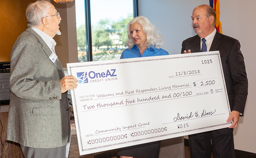 OneAZ President and CEO, Dave Doss along with Oro Valley Branch Manager Cindy Hanson present Community Impact Grant check to Southern Arizona Veterans and First Responders Living Memorial